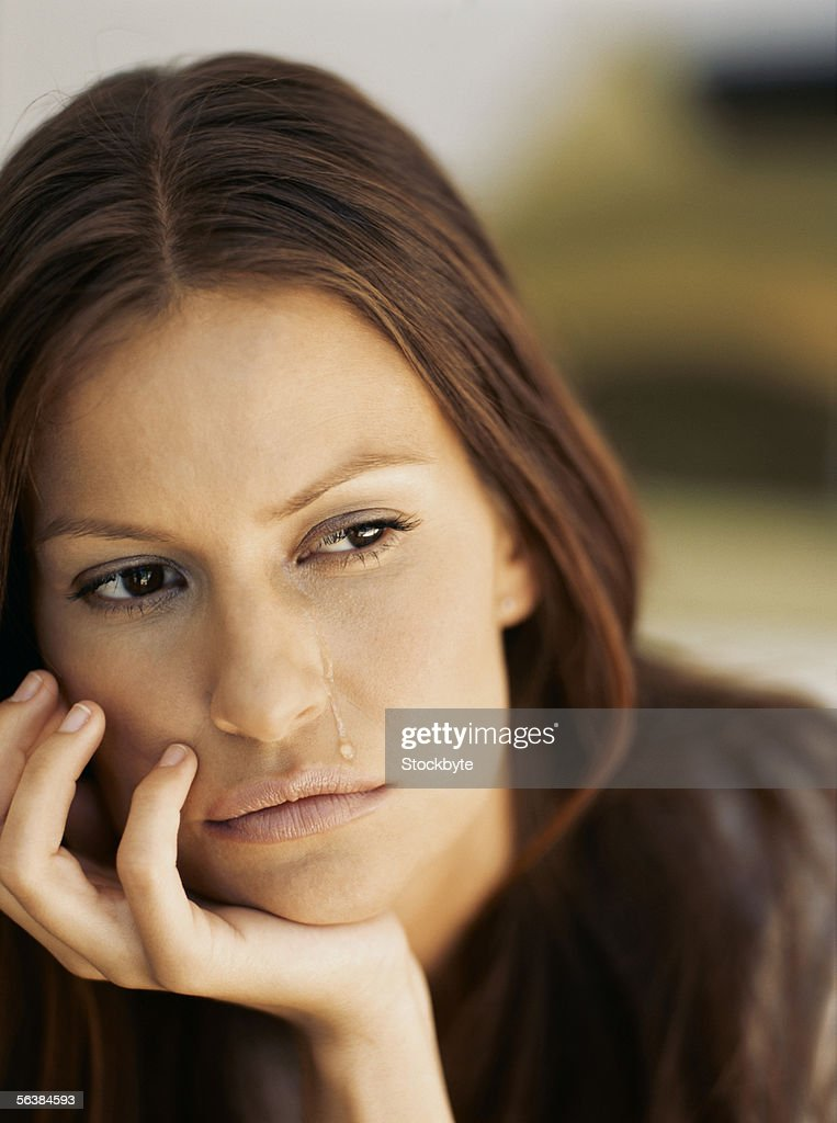 close-up of a young woman crying : Stock Photo