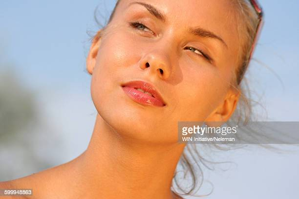 Close-up of a young woman day dreaming