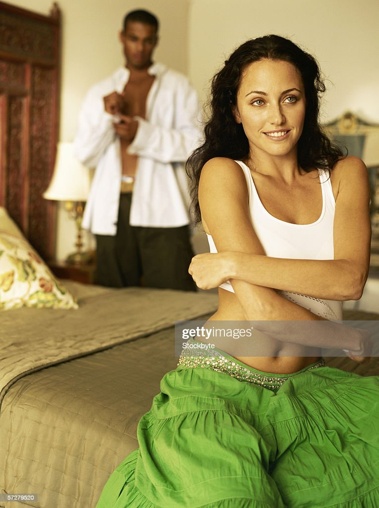 Closeup Of A Young Woman Getting Undressed High-Res Stock