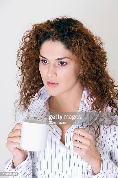 Close-up of a young woman holding a cup
