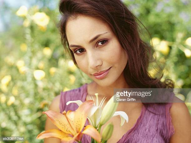 close-up of a young woman holding flowers