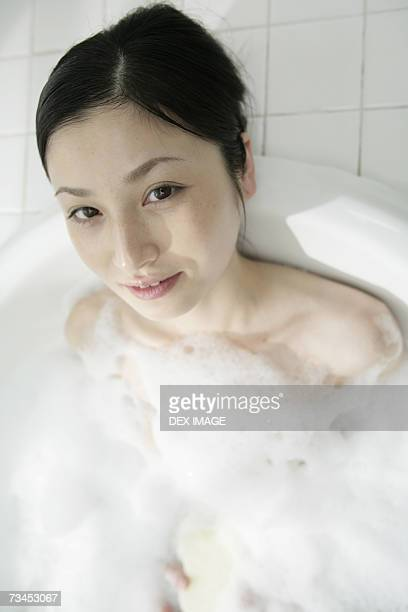 Close-up of a young woman in a bathtub