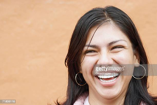close-up of a young woman laughing - hair part stock pictures, royalty-free photos & images