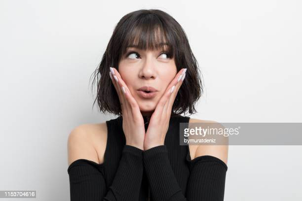close-up of a young woman looking away - hand on chin stock pictures, royalty-free photos & images
