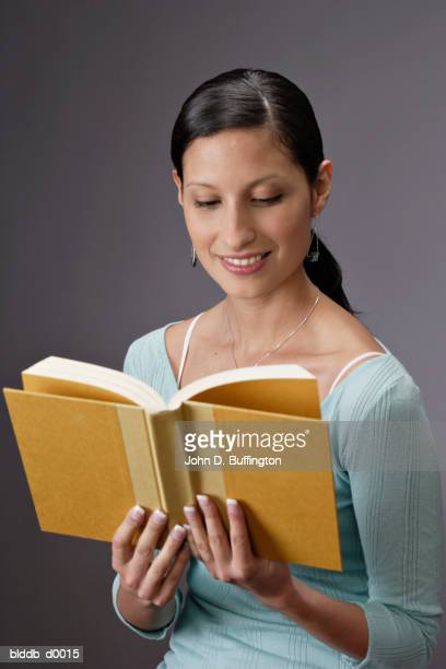 Close-up of a young woman reading a book