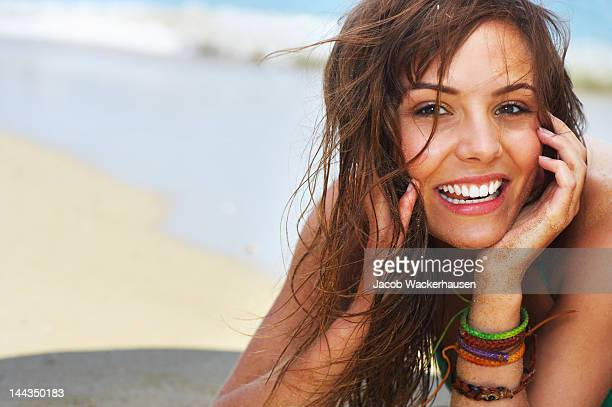 Close-up of a young woman relaxing on the beach