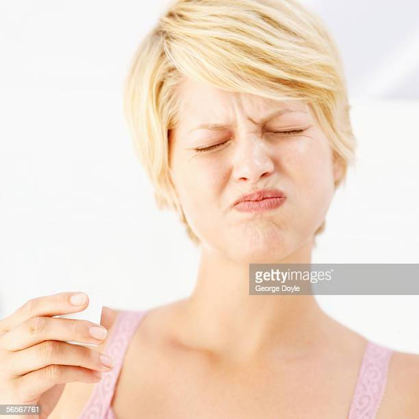 close-up of a young woman rinsing her mouth with mouthwash
