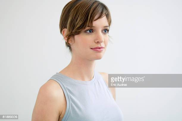 close-up of a young woman smiling - sleeveless top stock pictures, royalty-free photos & images