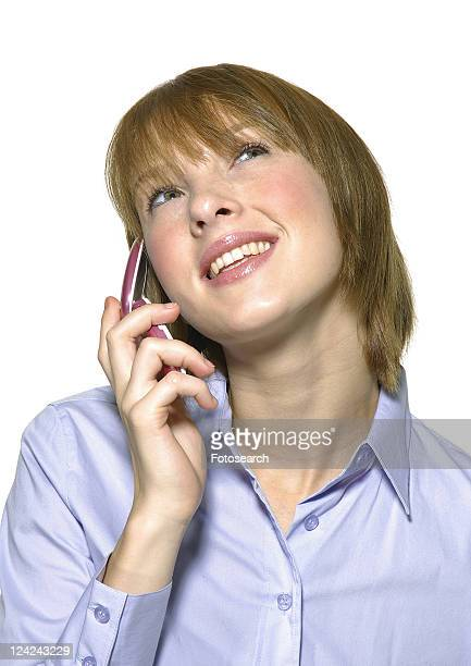 Close-up of a young woman talking on a mobile phone and smiling