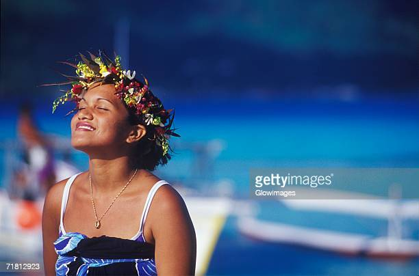 Close-up of a young woman wearing a laurel wreath, Hawaii, USA