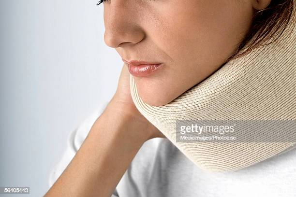 Close-up of a young woman wearing a neck brace