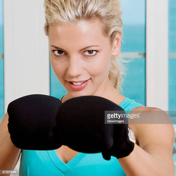 close-up of a young woman wearing boxing gloves - belly punching stock pictures, royalty-free photos & images
