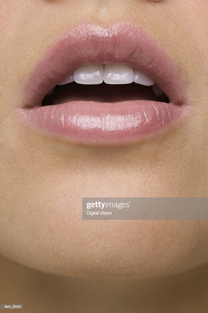 Close-up of a young woman with her mouth open : Foto de stock