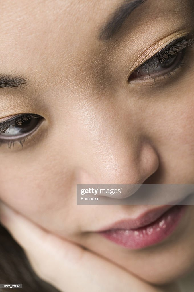 Close-up of a young woman's face : Foto de stock