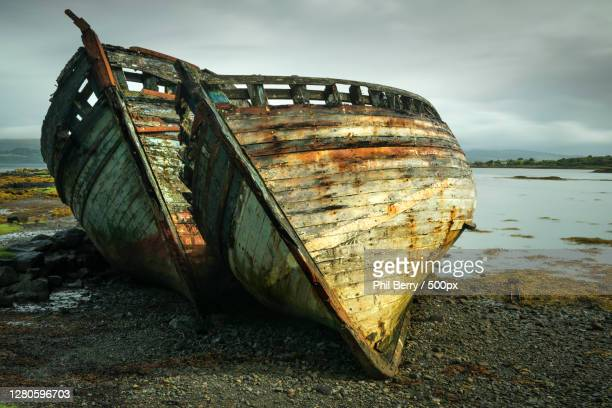 close-up of abandoned boat moored on beach against sky,salen,isle of mull pa je,united kingdom,uk - nautical vessel stock pictures, royalty-free photos & images