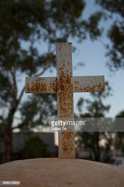 Close-up of abandoned cross outdoors