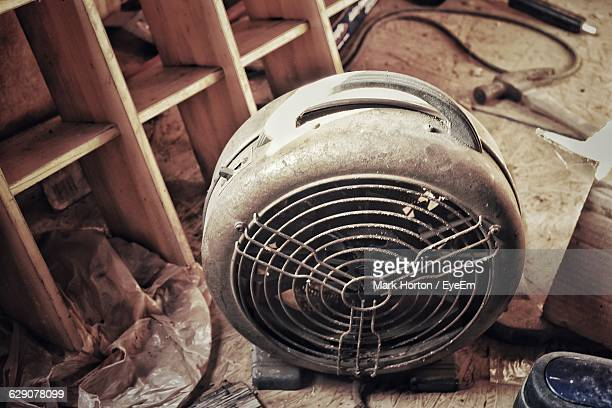 Close-Up Of Abandoned Electric Heater On Floor