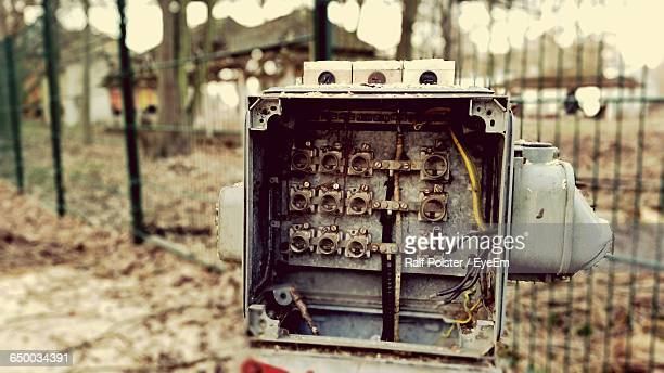 close-up of abandoned fuse box on field - electrical box stock pictures, royalty-free photos & images