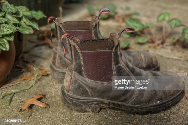 Close-Up Of Abandoned Shoes