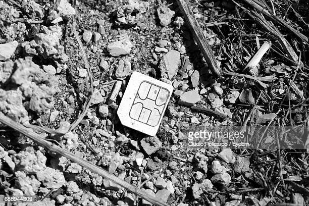 Close-Up Of Abandoned Sim Card On Field