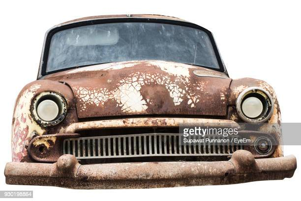 Close-Up Of Abandoned Vintage Car Against White Background
