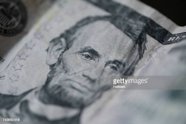 Close-up of Abraham Lincoln on US five dollar bill