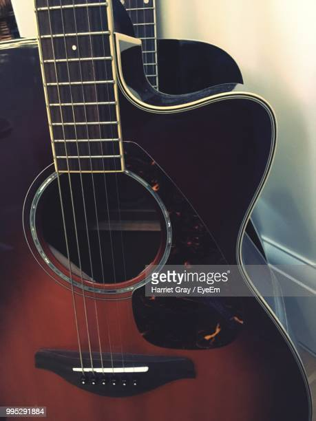 close-up of acoustic guitars - harriet stock photos and pictures