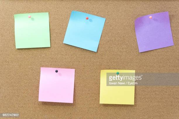 close-up of adhesive note against wall - adhesive note stock pictures, royalty-free photos & images
