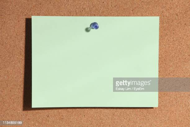 close-up of adhesive note on bulletin board - bulletin board stock pictures, royalty-free photos & images