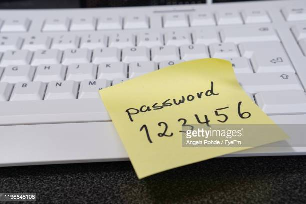 close-up of adhesive note on computer keyboard - password stock pictures, royalty-free photos & images