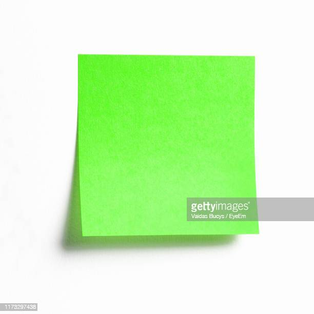 close-up of adhesive note on white background - post it stock pictures, royalty-free photos & images