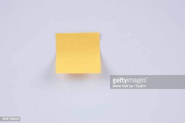 close-up of adhesive note on white background - adhesive note stock pictures, royalty-free photos & images