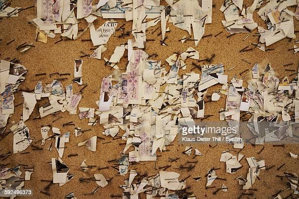Close-Up Of Adhesive Notes On Bulletin Board