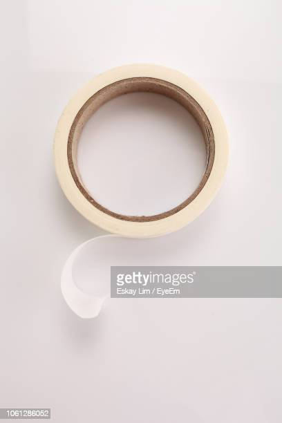 close-up of adhesive tape against white background - クルクルと巻いた ストックフォトと画像