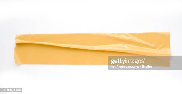 close-up of adhesive tape on white background - adhesive tape stock pictures, royalty-free photos & images