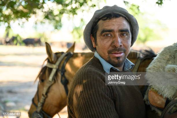 close-up of adult argentine gaucho preparing to ride horse - cordoba argentina stock pictures, royalty-free photos & images
