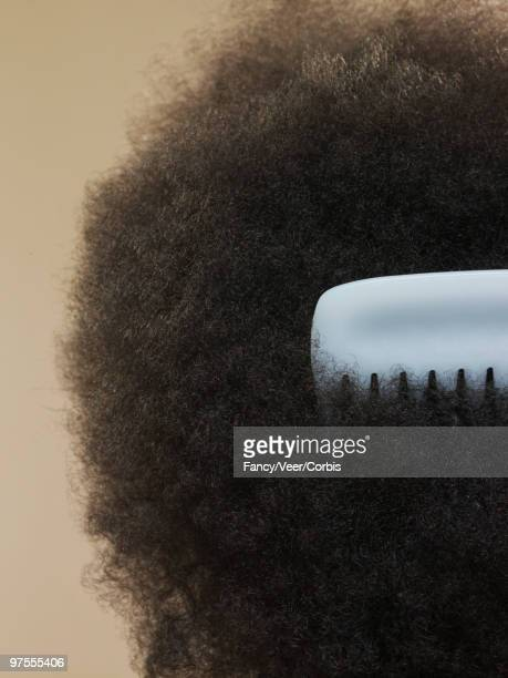 close-up of afro with comb - natural black hair stock pictures, royalty-free photos & images