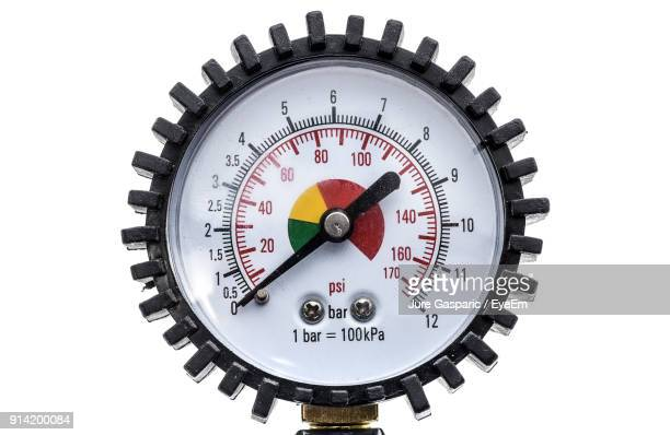 Close-Up Of Air Compressor Gun With Manometer Over White Background