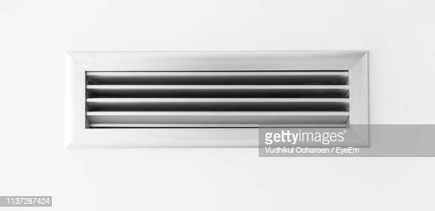 close-up of air duct on wall - air duct stock pictures, royalty-free photos & images