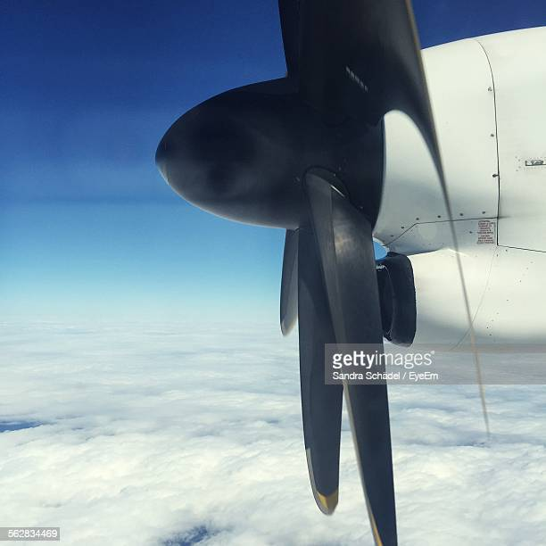 Close-Up Of Airplane Propeller Over Cloudscape
