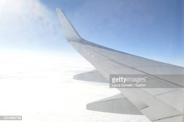 close-up of airplane wing against sky - aircraft wing stock pictures, royalty-free photos & images