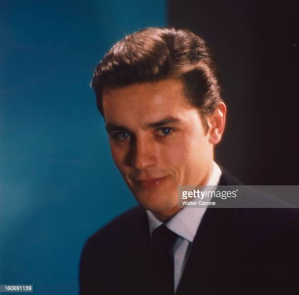 Closeup Of Alain Delon Photo studio portrait de face souriant d'Alain DELON légèrement de troisquarts en veste noire chemise blanche et cravate noire...