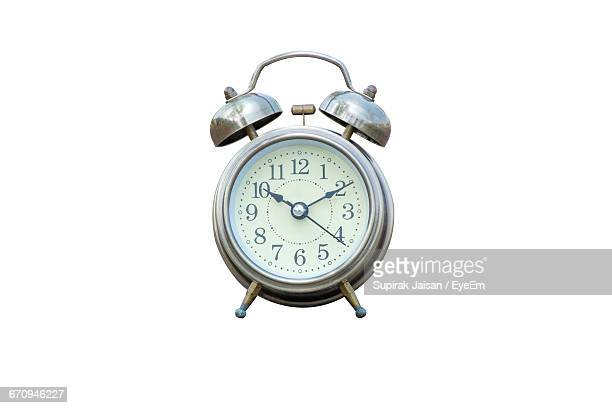 Close-Up Of Alarm Clock Against White Background