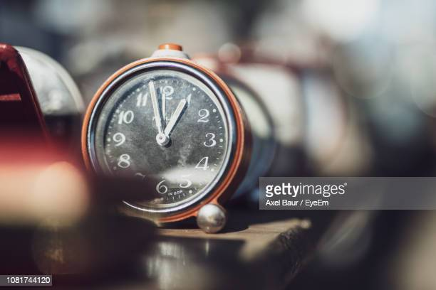 close-up of alarm clock on table - time of day stock pictures, royalty-free photos & images