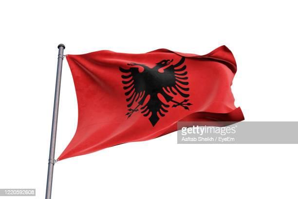 close-up of albanian flag against clear sky - bandiera albanese foto e immagini stock