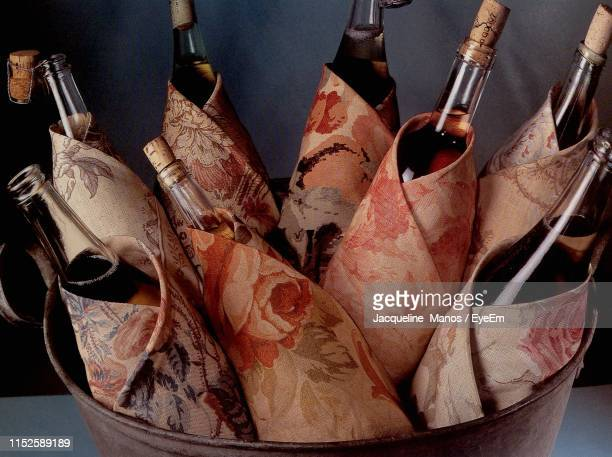 close-up of alcohol bottles in bucket on table - モデナ ストックフォトと画像