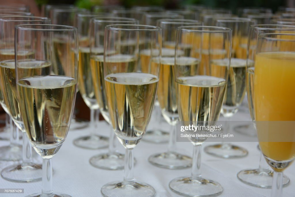 Closeup Of Alcohol Glasses On Table At Wedding Reception Stock Photo