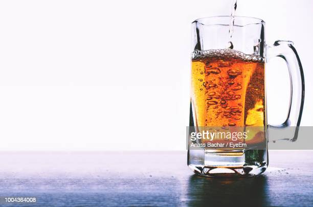 Close-Up Of Alcoholic Drink On Table Against White Background