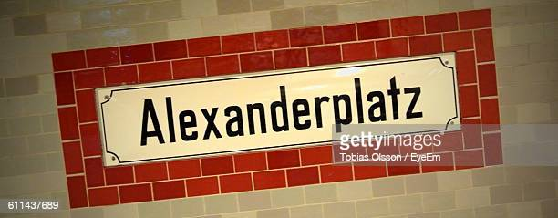 close-up of alexanderplatz sign on the wall - underground sign stock pictures, royalty-free photos & images