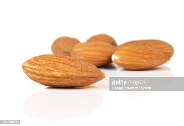 Close-Up Of Almond Against White Background